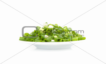 chopped green onions on a plate