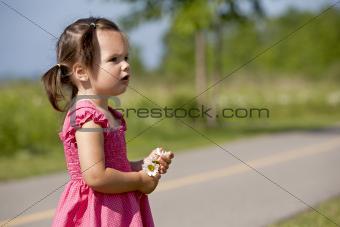 toddler holding flower
