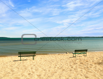 empty beach with benches