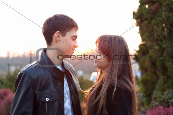 Young couple in love in sunny outumn autdoors