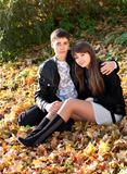 Young couple in love hug in autumn outdoors