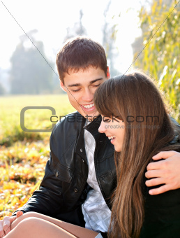 Happy smiling couple in love having fun autumn sunny day