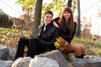 Young happy smiling couple in autumn outdoors