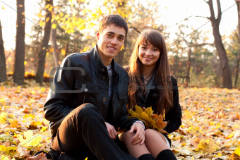 Young happy couple in autumn park