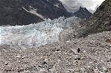 Hiker on glacier moraine