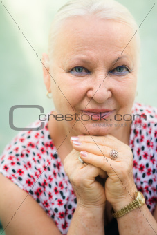 Old caucasian woman smiling at camera