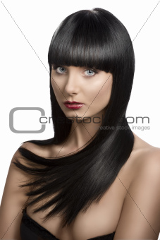 girl's portrait with long dark hair, slightly turned of three qu