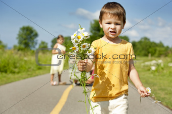 toddler smelling flower