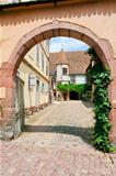 yard in medieval Riquewihr town, France