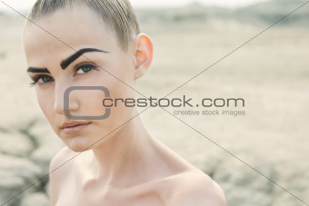 Fashion portrait of beautiful woman posing on lightfull backgrou