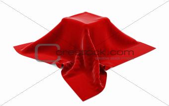 Box hidden under red velvet cloth isolated on white.