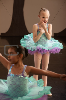 Young Ballet Student Watches Friend