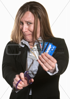 Nervous Woman Cuts Credit Cards
