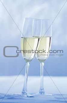 toast in the snow with champagne