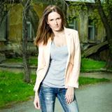 Fashion portrait of beautiful woman posing on old school backgro