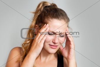 portrait of a caucasian woman with headache