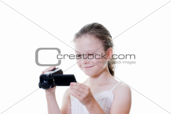 preteen girl with video camera