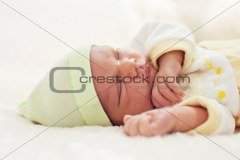 Closeup portrait of a one week old baby boy asleep