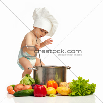 Little boy with ladle, pot, and vegetables