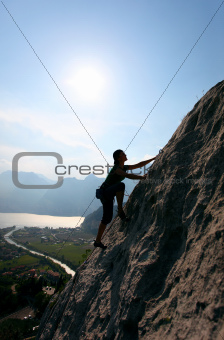 Silhouette of female rock climber
