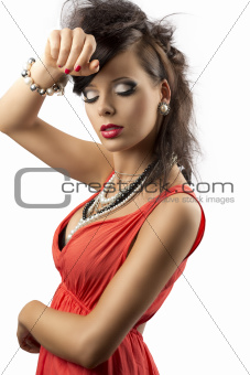 portrait of fashion brunette with hand on her front