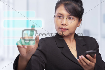 Asian businesswoman with touch screen