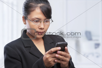Asian businesswoman using cell phonr