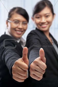 Two Asian businesswoman with thumbs up