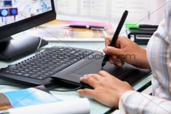 Female graphic designer using tablet pen