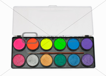 face paint palette and brush over white background