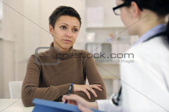 Psychologist and depressed patient at office