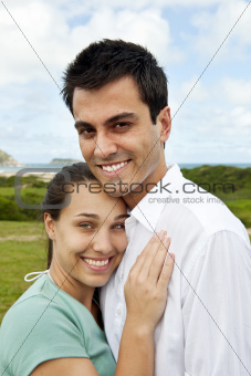 happy hispanic couple smiling