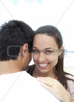 Young woman and boyfriend on the beach