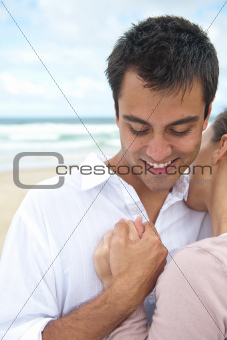 Latin man and girlfriend on the beach