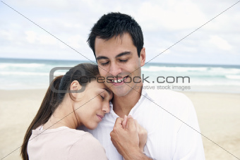 hispanic couple bonding on beach