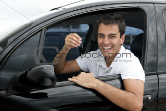 Happy hispanic man in his new car