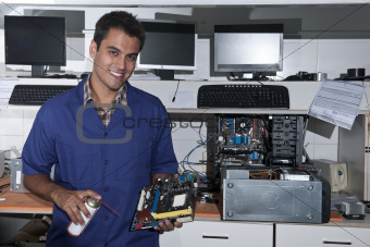 computer technician with motherboard at workshop