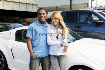 multiethnic couple buying a new car
