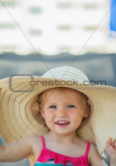 Portrait of baby in beach hat