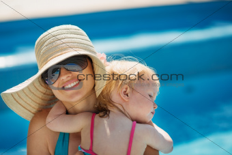 Portrait of baby hugging mother