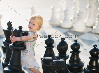Baby playing in chess