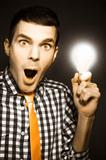 Male Business Person With Light Bulb In Hand