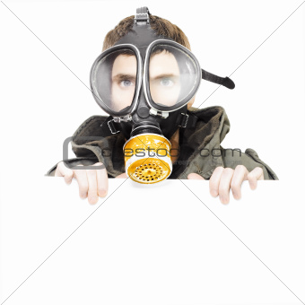 Isolated man wearing gas mask holding blank sign