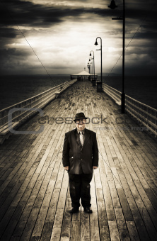 Senior Male Standing On A Pier Promenade
