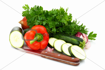 Fresh vegetables, parsley and knife.