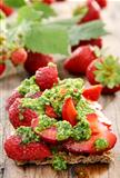 Strawberry toast with pesto and fresh strawberries.