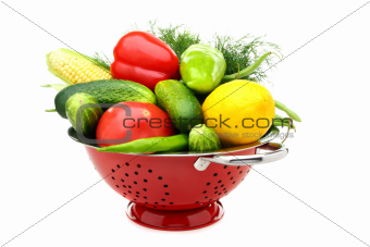 Summer vegetables in metal colander.