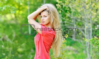 Beautiful young woman posing outdoors