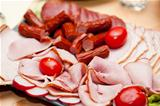platter of cold cuts and sausages with ham and tomatoes