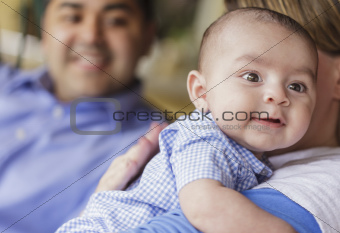 Happy Attractive Mixed Race Couple Burping Thier Smiling Son.